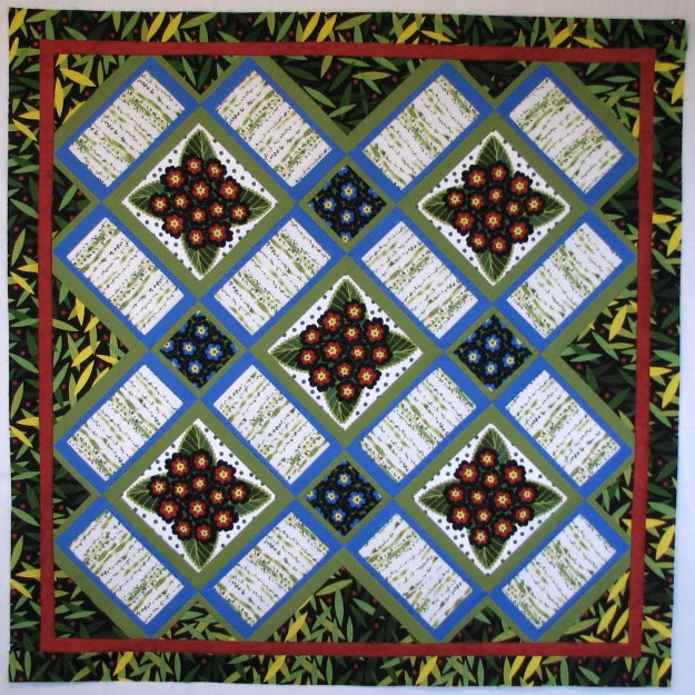 Garden Windows quilt with red and blue flowers