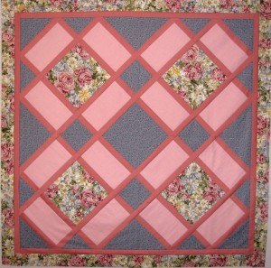 Garden tiles quilt in pinks and blues