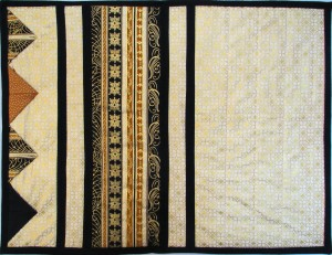 Gold, black and cream striped placemat with prairie points