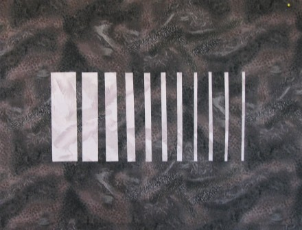 Square cut in strips showing negative space