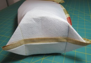 "Round out the bottom of the quiver by sewing two ""ears"" as shown."