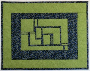 A cut up rectangle demonstrates the use of negative space in a quilt design.