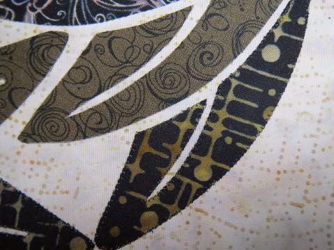 Lower leaf has been machine stitch appliqued (blanket stitch with silk thread)