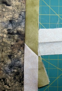 Testing the stitched seam against the quilt edge