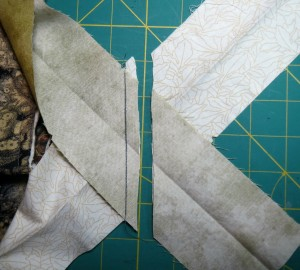 Cut the loose ends to make a 1/4 to 1/2 inch seam allowance