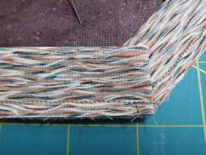 Stitch the second edge, backstitching to the corner and then going forward