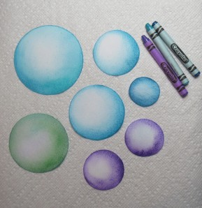 Spheres colored with melted crayons - first try