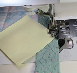 Stop stitching as the needle reaches the paper