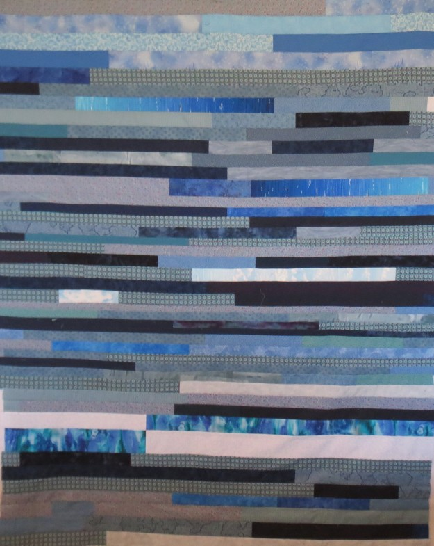 Strip pieced back for blue diamond quilt