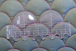 clamshell template placed on completed stitching
